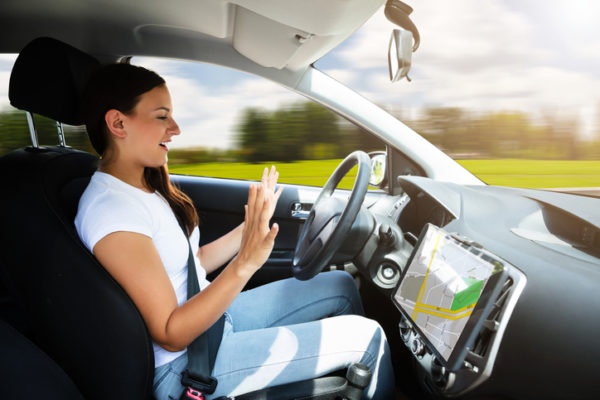 A young woman in a self-driving car