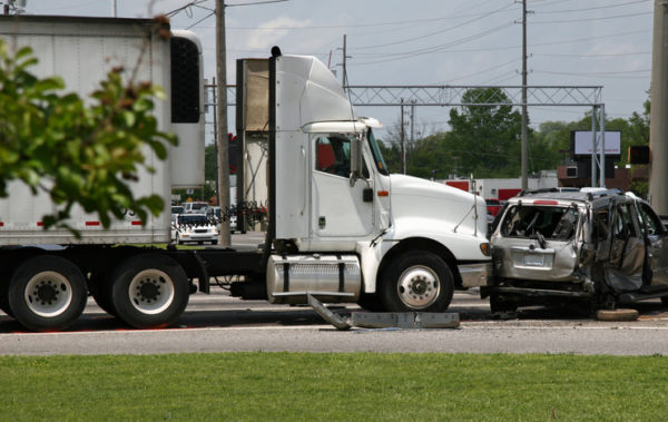 A vehicle being T-boned by a tractor-trailer big rig